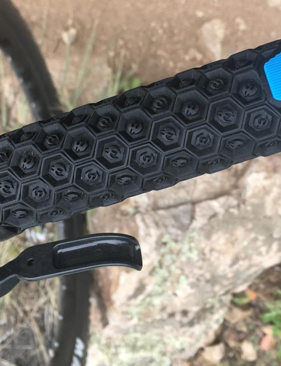 WTB's Padloc grips are on board. The blue wedge is a solid rubber piece said to increase hand comfort