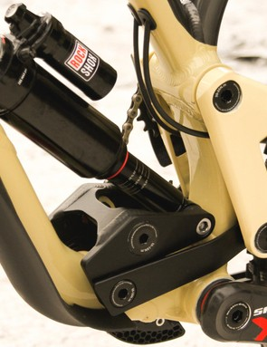 The linkage on the Commencal looks complex, but gives a high pivot placement without interference from the chain