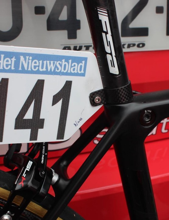 The blacked out bike features a svelte carbon race number holder