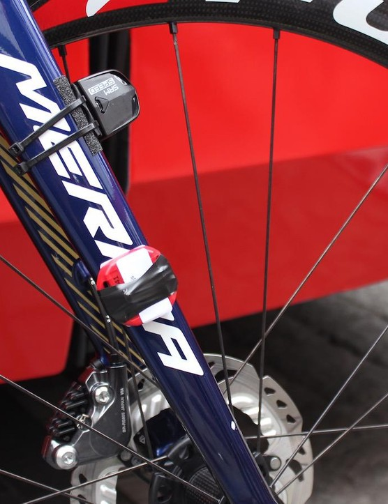 The SRM speed sensor and race timing chip are crudely attached to the fork