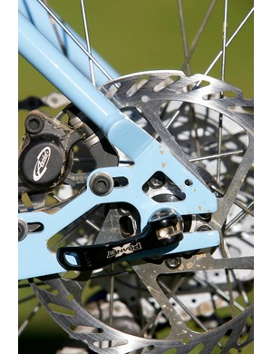 Slotted dropouts with a slotted rear disc mount make a singlespeed conversion quick and easy