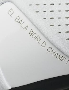 The instep of the shoe has the inscription
