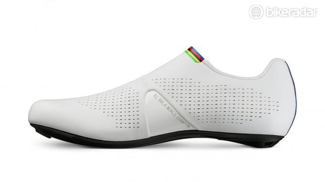Rainbow accents feature on the tongue and heel of the shoe