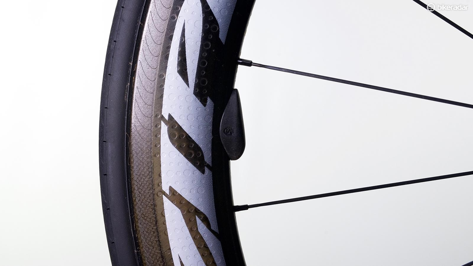 The SpeedBalance uses a 3M adhesive to stick to carbon rims