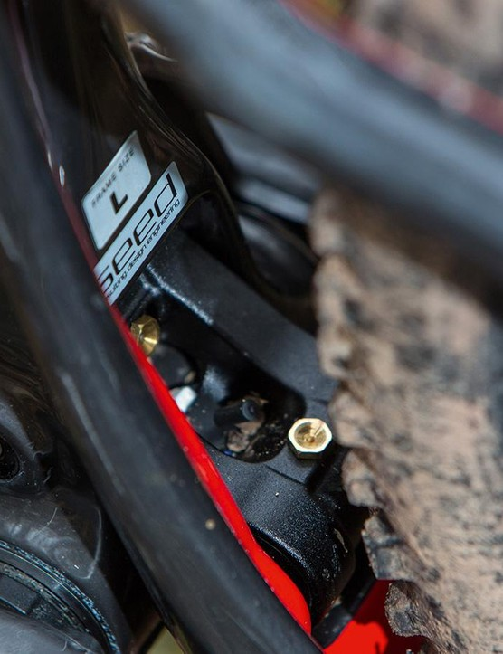 The lower link pivots inside the seat tube, allowing short stays