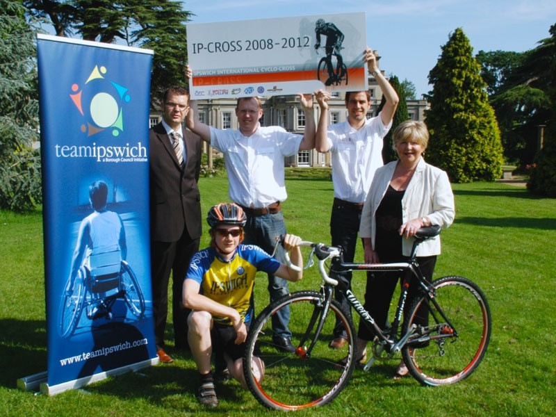Ipswich Council executives celebrate the win along with a local rider and the bid organisers