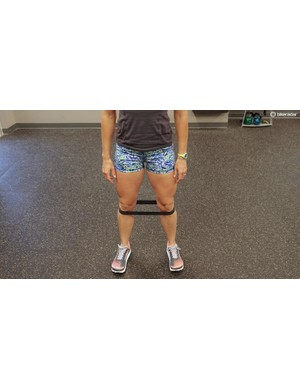 That same band can be used for squats — for most suffering from IT Band issues, bodyweight is sufficient. Aim for 15-20 reps, with good form — keep the knees in line with the feet