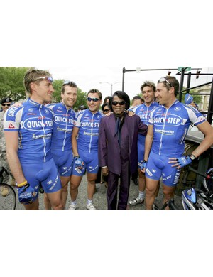James Brown, the godfather of soul, takes a photo op with the QuickStep team at the 2006 Tour of Georgia. He's the one wearing a shiny, satin pant suit.