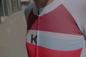 The jersey features a full-length zip and a low collar