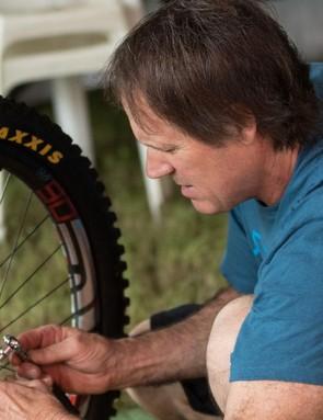 Doug Hatfield, veteran MTB race mechanic doing some minor adjustments between practise laps
