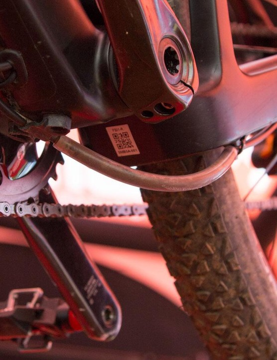 Looking beneath reveals some protective plastic saving the rear brake hose from possible rock strikes