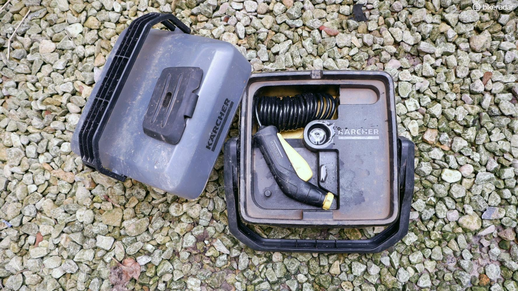 When not in use, the hose coils up neatly inside the box