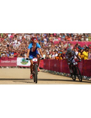 Jaroslav Kulhavy of the Czech Republic outpaces Nino Schurter of Switzerland to win the men's mountain bike race on day 16 of the 2012 Olympic Games at Hadleigh Farm on 12 August 2012 in Hadleigh, Essex