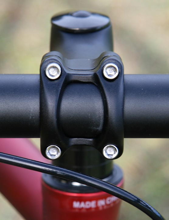 Four bolt clamp hold the bars securely.