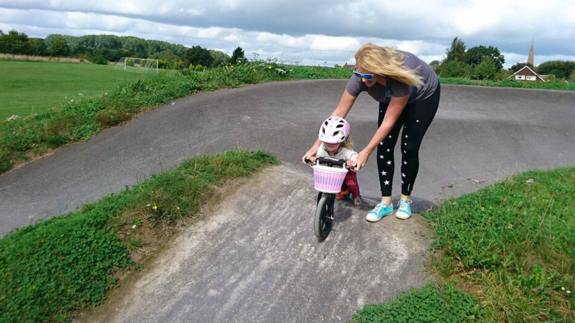 Jennifer Purcell and her daughter on one of the pump tracks in a neighbouring village