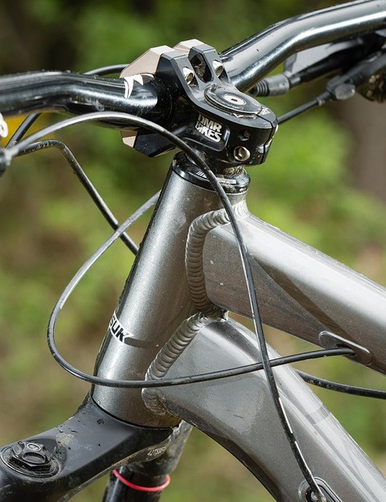 The frame's internal cable routing is designed for a British brake setup