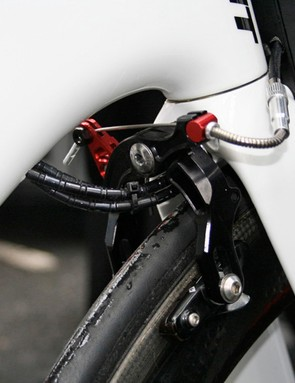 Cables pass through the front wedge and through the fork, under the front brake and then into the underside of the down tube.