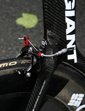 The rear brake is hidden behind the seat tube, where you'd normally find it on most bikes.