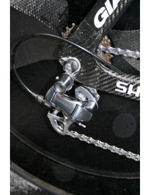 The Dura-Ace rear derailleur is bolted to a replaceable aluminium hanger below the rear facing dropouts.
