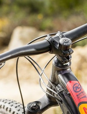 The pleasing short stem / wide bar cockpit is formed from solid own-brand components
