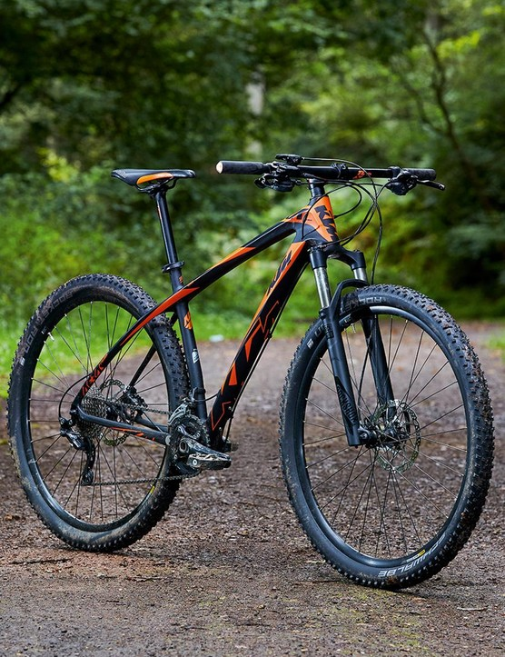 With its super-steep head angle, down-sloped stem and tapered silicone grips, the KTM has a proper old-school XC race feel