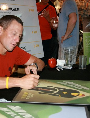Lance Armstrong signs posters at Mellow Johnny's May 10.