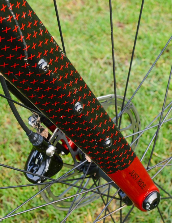 There are loads of bosses on the fork, but no mudguard mounts