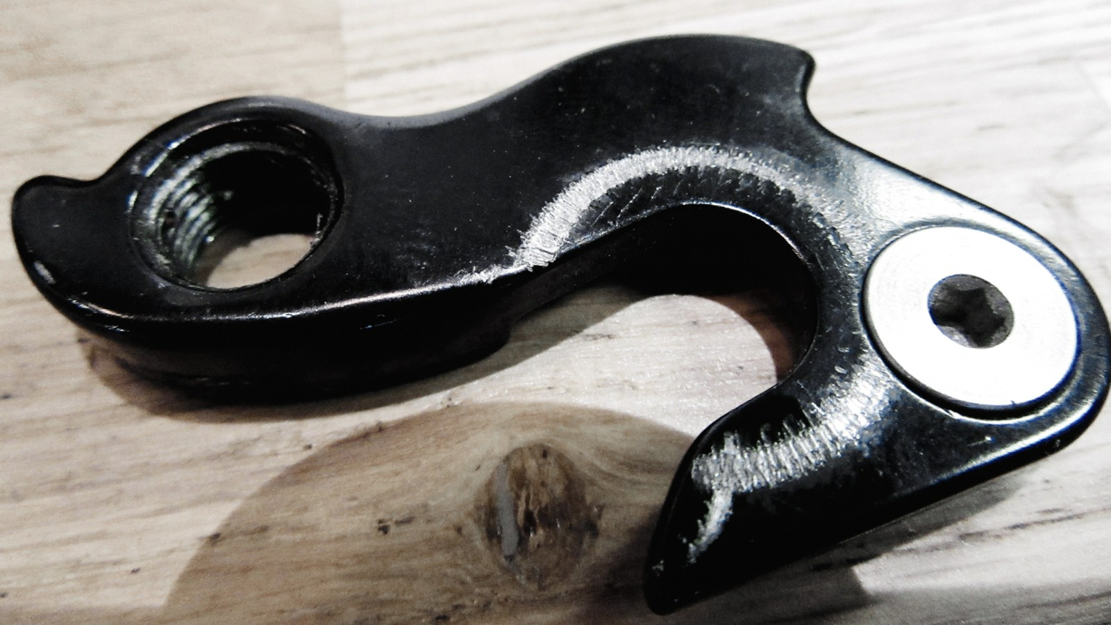 A derailleur hanger isn't heavy or costly. Having a spare on you for a long race day can make a world of difference
