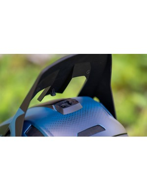 The visor is fixed in position by a safety release clip, designed to break free in a crash