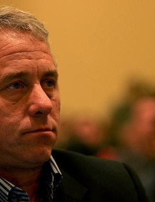 Greg LeMond listens to Armstrong at the September 26 press conference in Las Vegas.
