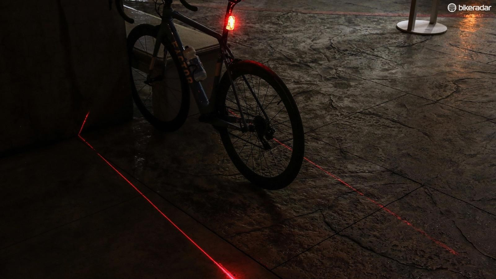 The ground laser lights extend back about twice the length of the bike