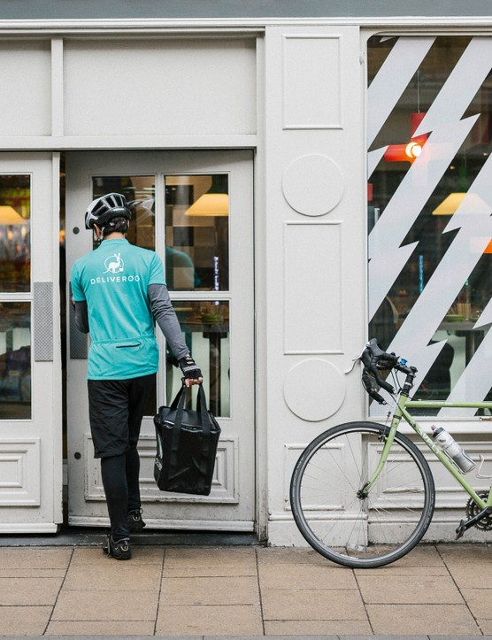 An app tells Deliveroo riders where to collect from and deliver to