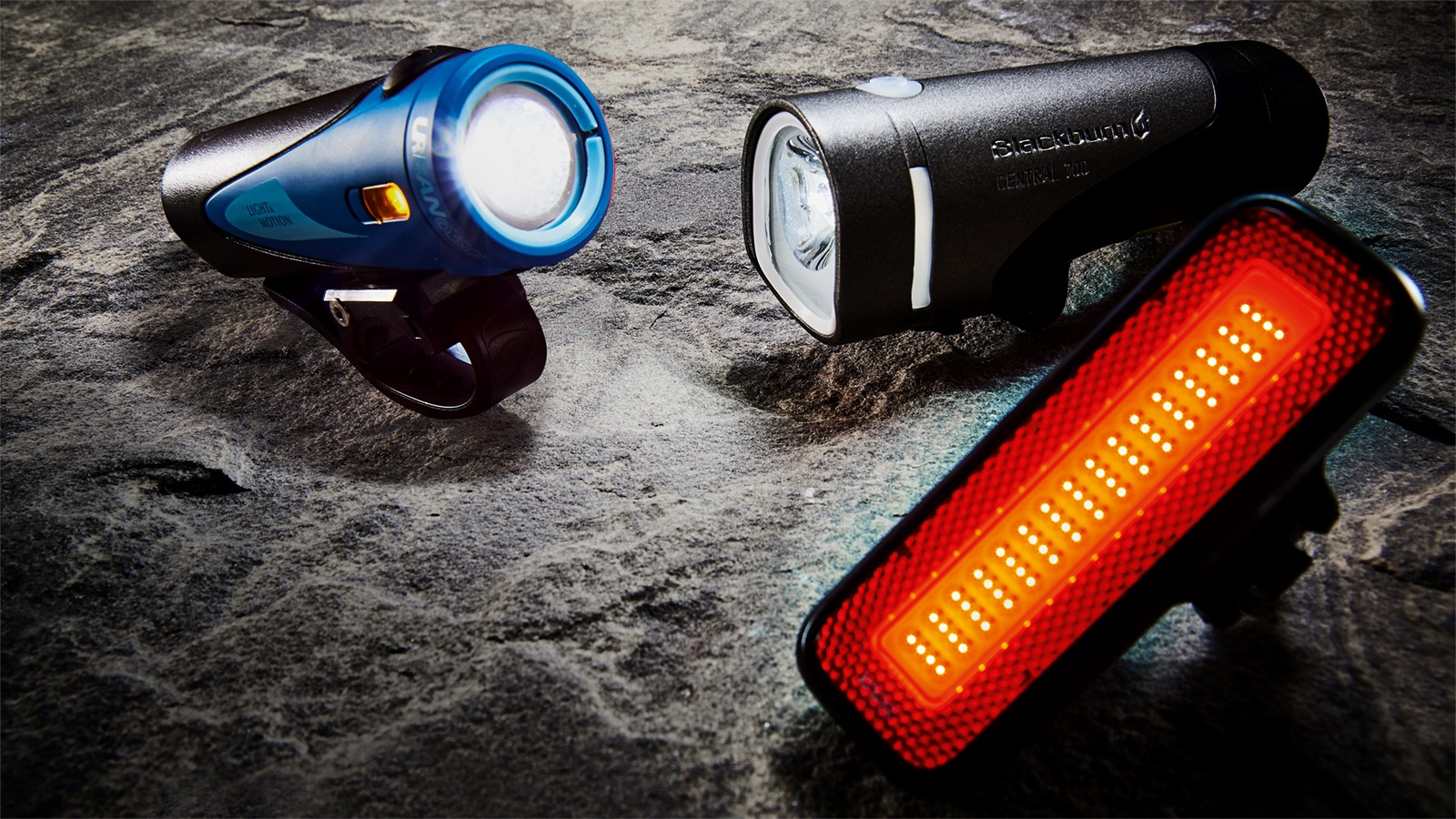 The minimum equipment for riding a bike at night in the UK includes a front light (white), a rear light (red), and reflectors