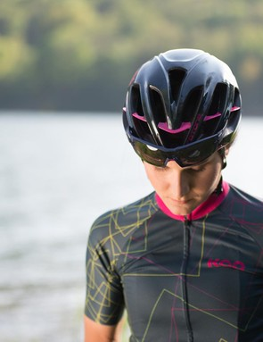 Elisa Longo-Borghini models the helmet and jersey from the collection