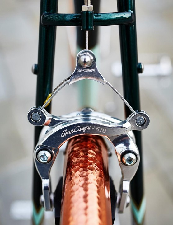 Dia-Compe 610 centre pull brakes sit atop the copper-toned, hammered rear mudguard