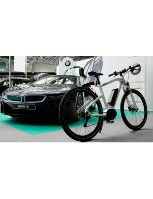 Proudly placed next to BMW's i8 hybrid car was one of the firm's e-bikes