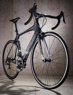 The fork legs are slender and the top tube hourglass-shaped