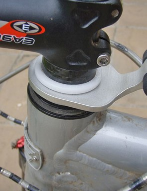 The nylon steerer tube spacer that holds the swivelling mount just sits under the stem