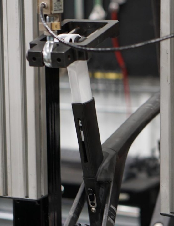 Testing is done to ISO standards as well as Trek's own internal standards. This seatmast test loads and unloads 270lb for 100,000 cycles