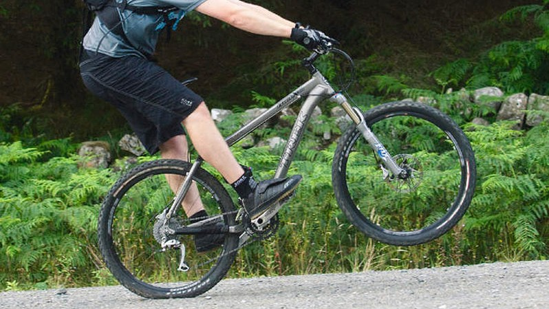 Shift your weight back over the bike's bottom bracket