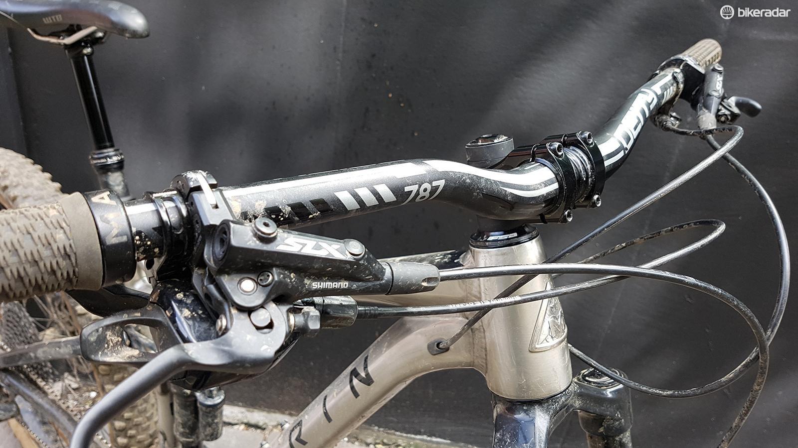Wide Deity bars aren't often seen as standard on bikes