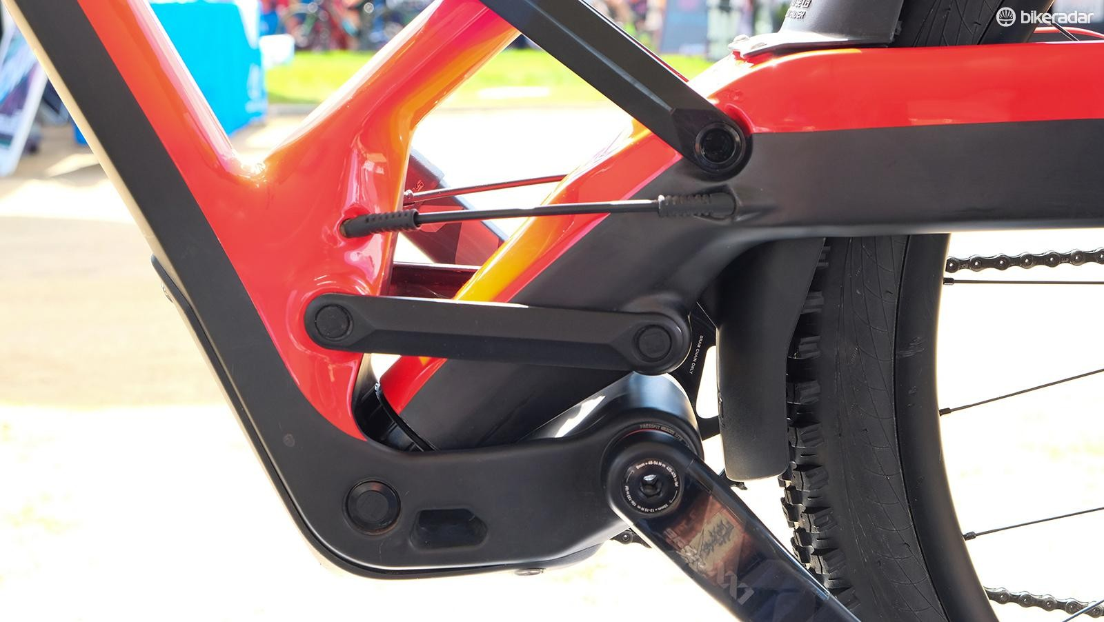A pair of links connect the swingarm to the frame