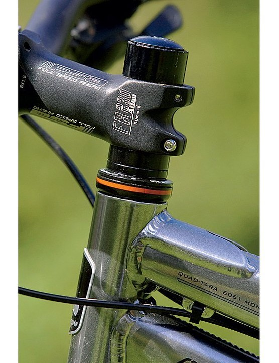 The FSA double-clamp stem is a quality item and there's over an inch of steerer tube spacers for hei