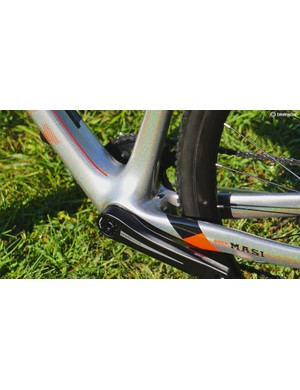 Just ahead of the tire is a fender mount and a front derailleur cable port