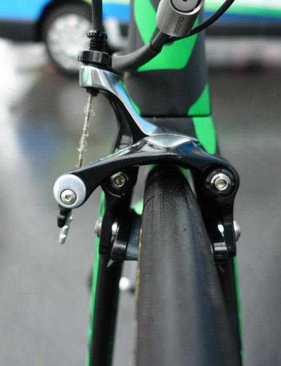 Direct-mount calipers front and rear. An inline adjuster acts as a quick release for the rear brake