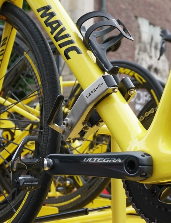 As with the team cars, Mavic neutral support has quick-release racks, so mechanics can grab a bike with one hand and release it with the other. The wheels sit in trays unstrapped