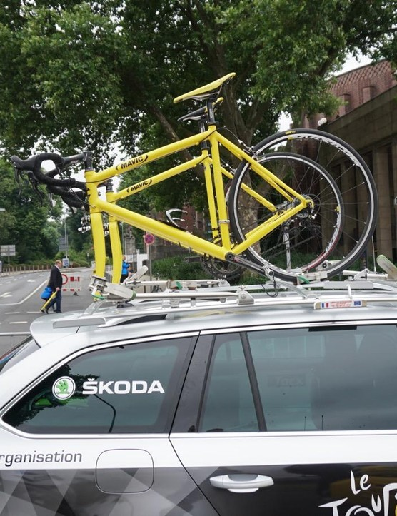 The Tour de France organisation cars have yellow bikes, but these are merely ornamental