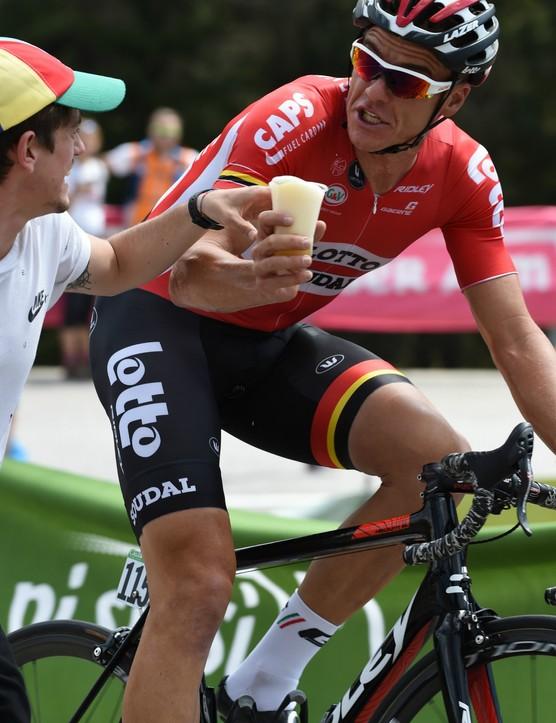 Adam Hansen (Lotto-Soudal) enjoys a cheeky mid-ride beer
