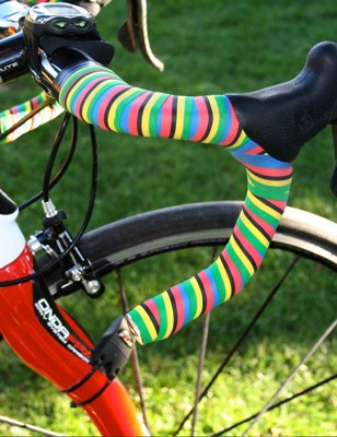 The world champion has bar tape to match the rainbow on her jersey.