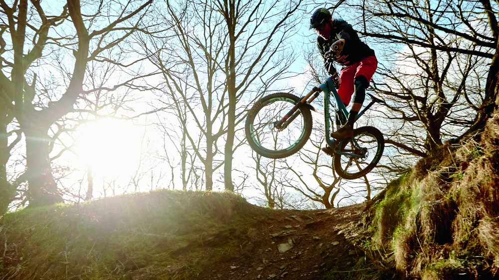 Steve Peat styles it up at his local riding spot